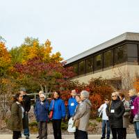 Tour group stops to talk about Mackinac Hall